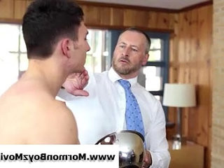Older gay mormon in suit spanks and jacks youthful guy